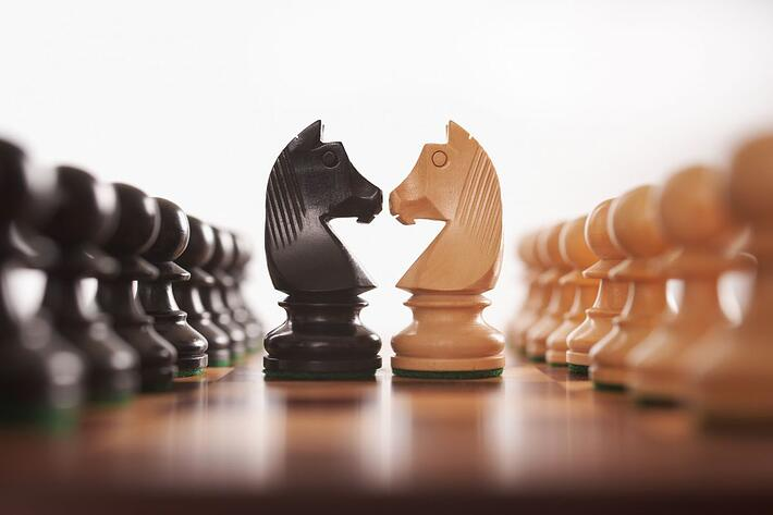 Chess pieces visualzing the importance of strategically placed applications